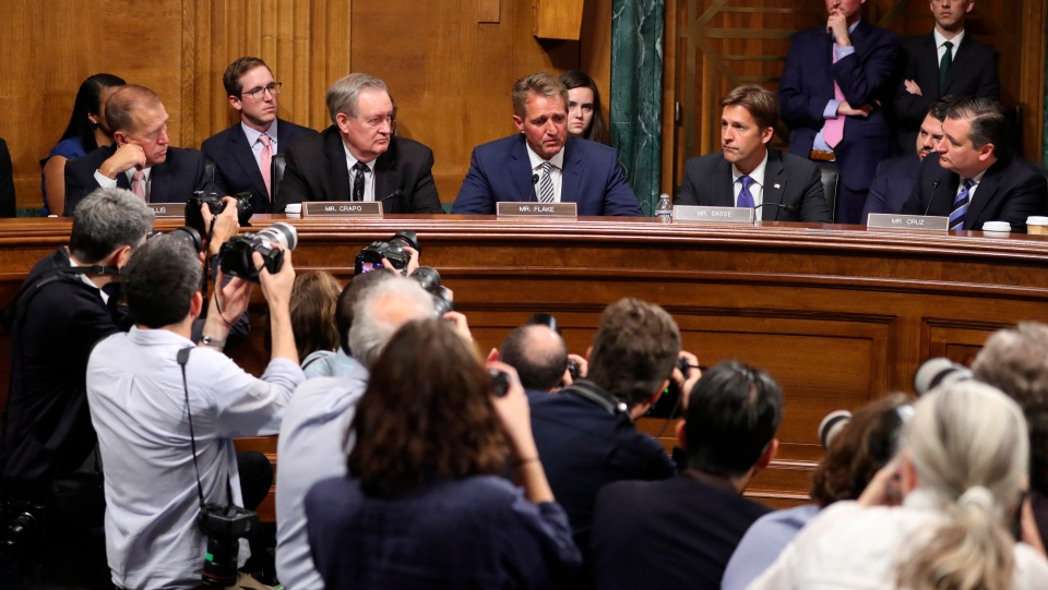 Sen. Jeff Flake, R-Ariz., speaks during the Senate Judiciary Committee meeting on Friday, Sept. 28, 2018, on Capitol Hill in Washington. Flake said it would be 'proper' to delay a Senate floor vote on Supreme Court nominee Brett Kavanaugh for a week. (AP Photo/Andrew Harnik)
