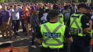 Police keep Western University students at bay during FOCO on Sept. 29, 2018. (Brent Lale/CTV)