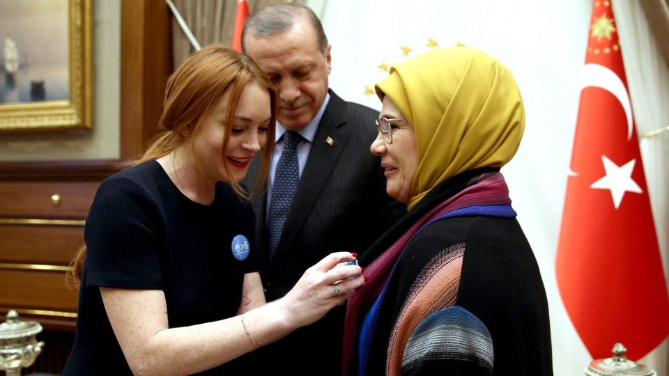 Lohan with Turkey's President Recep Tayyip Erdogan and his wife Emine Erdogan in 2017. Lohan volunteered in Turkey with Syrian refugees in early 2016. (Yasin Bulbul)