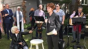 Karen Fraser (holding mic) speaks in front of her home on Mallory Crescent on Sept. 29, 2018. (Cristina Tenaglia/CP24)