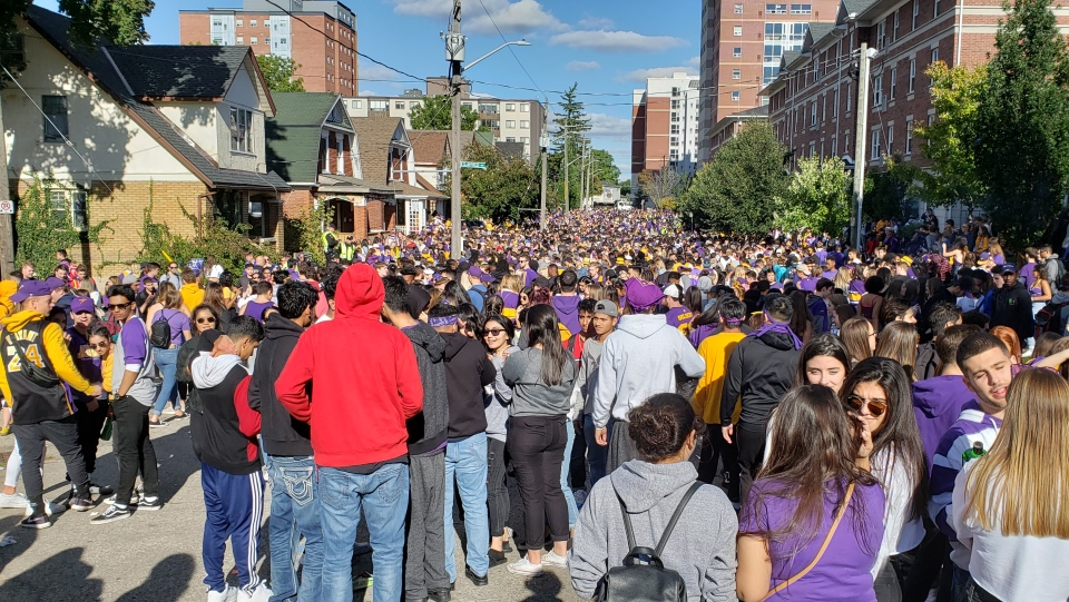 Thousands crowded Ezra Avenue during Wilfrid Laurier University's homecoming. in this undated file photo