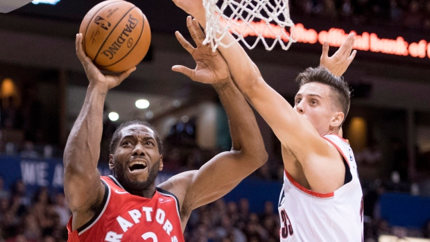 804f390465d5 Toronto Raptors forward Kawhi Leonard (2) fights for control of the ball  with Portland Trail Blazers forward Zach Collins (33) during pre-season NBA  action ...