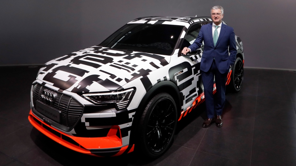 In this Thursday, March 15, 2018 file photo, Rupert Stadler, CEO of German car producer Audi, poses besides an Audi e-tron prototype car prior to the annual press conference in Ingolstadt, Germany.