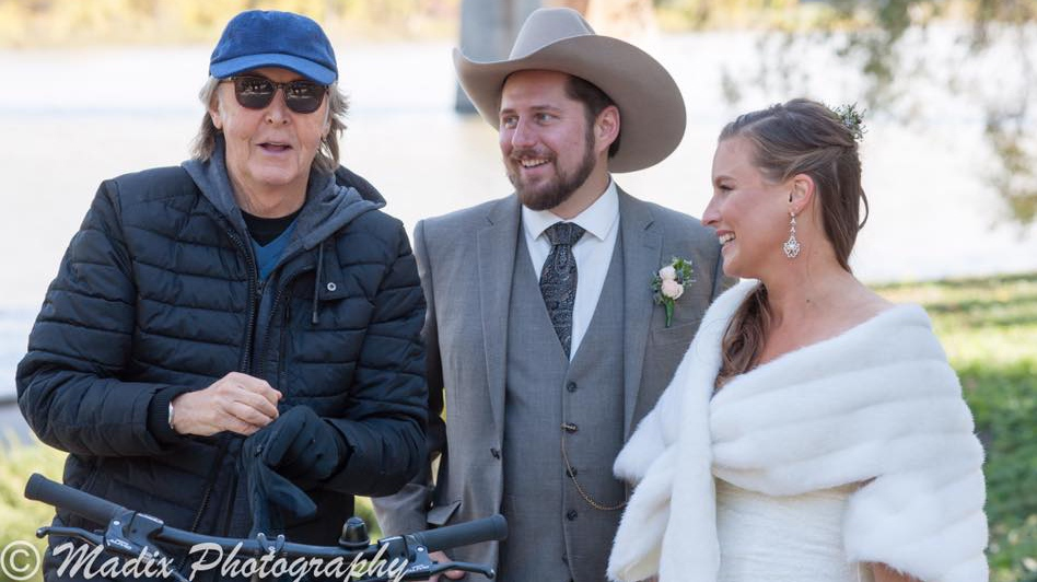 Paul McCartney takes pictures with a couple on their wedding day. (Source: Laurie Dixon/Madix Photography)