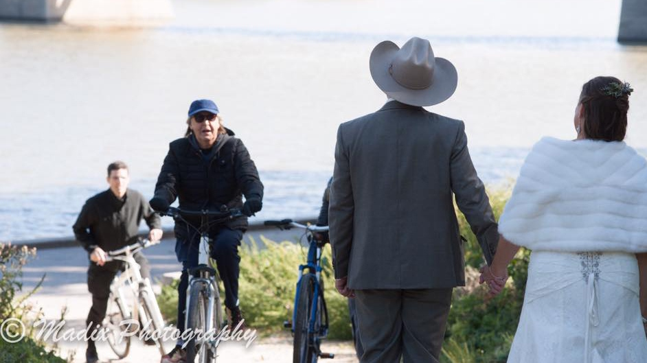 Paul McCartney was riding his bike where a couple was taking their wedding photos. (Source: Laurie Dixon/Madix Photography)
