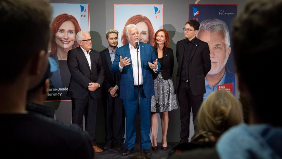Quebec Liberal Leader Philippe Couillard, flanked by candidates, from left to right, Serge Simard, Alexandre Duguay, Philippe Couillard, Marie-Josee Morency and Mathieu Huot, calls on his supporters at a campaign stop in Saguenay, Que., Sunday, Sept. 30, 2018. (THE CANADIAN PRESS/Jacques Boissinot)