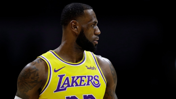 fcb45dd50b7 LeBron James captivates crowd in Los Angeles Lakers debut. lebron james