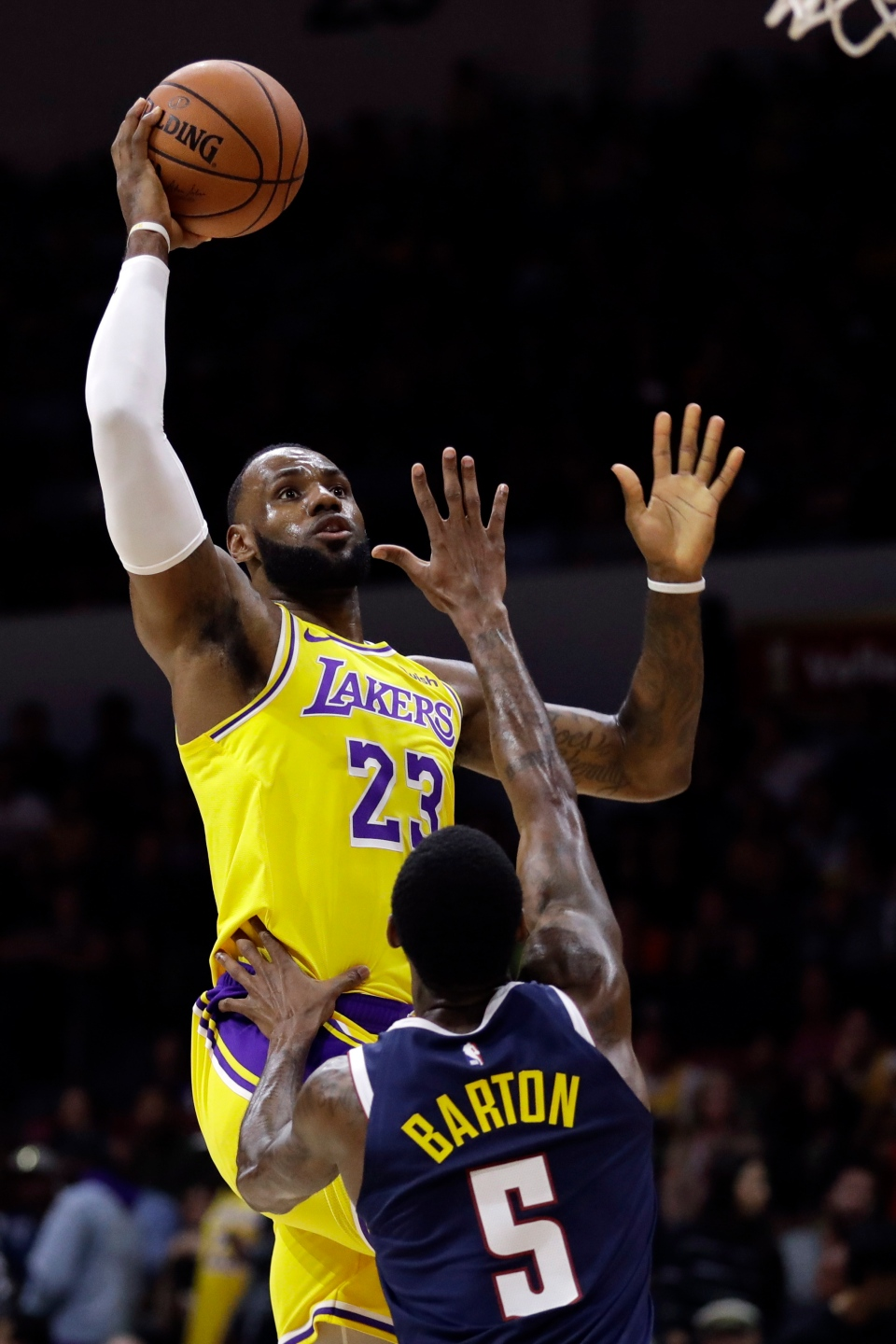 31abd17a4f9 Los Angeles Lakers forward LeBron James (23) shoots over Denver Nuggets  guard Will Barton (5) during the first half of an NBA preseason basketball  game