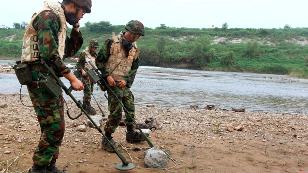 North and South Korea begin removing DMZ mines to ease military ... 23dd1d8d5