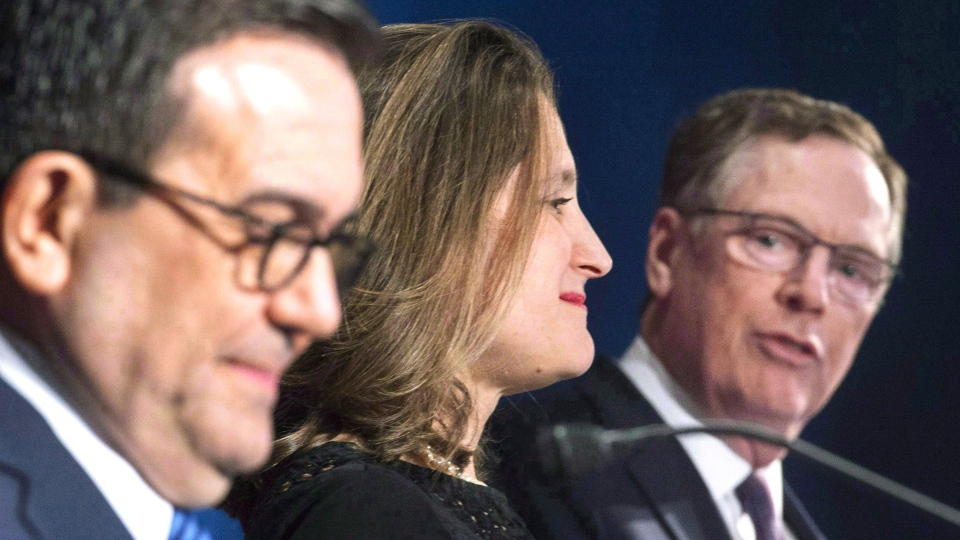 Foreign Affairs Minister Chrystia Freeland and Mexico's Secretary of Economy Ildefonso Guajardo Villarrea look on as United States Trade Representative Robert Lighthizer delivers his statements to the media during the sixth round of negotiations for a new North American Free Trade Agreement in Montreal, Monday, January 29, 2018. THE CANADIAN PRESS/Graham Hughes