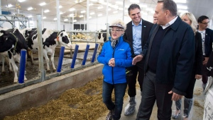 Coalition Avenir Quebec Leader Francois Legault chats with Diane Gilbert, co owner, as he visits a dairy farm, Tuesday, September 25, 2018 in Saint-Henri-de-Taillon Que. THE CANADIAN PRESS/Jacques Boissinot