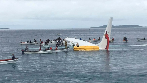 Air Niugini now says 1 missing after crash landing in Pacific lagoon