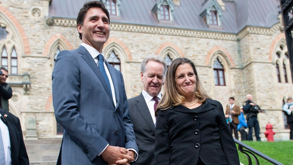 Prime Minister Justin Trudeau, negotiator Steve Verheul and Minister of Foreign Affairs Chrystia Freeland walk to a press conference on the USMCA trade deal on Parliament Hill in Ottawa on Monday, Oct. 1, 2018. (THE CANADIAN PRESS / Justin Tang)