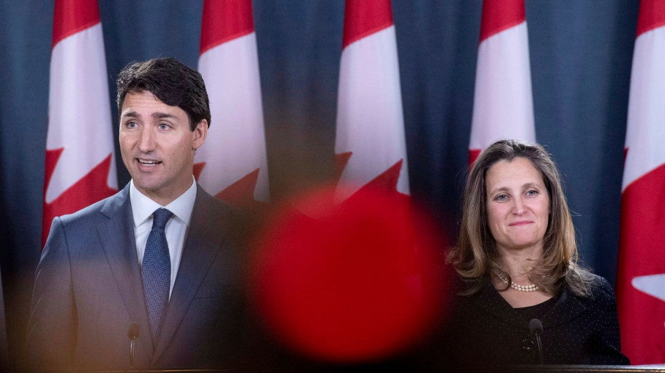 Prime Minister Justin Trudeau and Minister of Foreign Affairs Chrystia Freeland hold a press conference regarding the United States Mexico Canada Agreement (USMCA) at the National Press Theatre, in Ottawa on Monday, Oct. 1, 2018. THE CANADIAN PRESS/Justin Tang