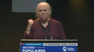 Manon Massé raises her fist as she declares her pride in Quebec Solidaire
