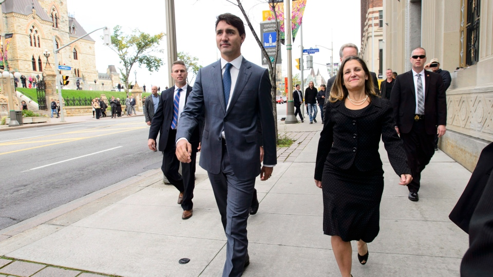 Prime Minister Justin Trudeau and Minister of Foreign Affairs Chrystia Freeland make their way to hold a press conference regarding the United States Mexico Canada Agreement (USMCA) on Monday, Oct. 1, 2018. THE CANADIAN PRESS/Sean Kilpatrick