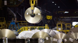 A roll of galvanized steel is moved inside one of Arcelor Mittal Dofasco's galvanizing mills in Hamilton, Ont., on Tuesday, August 14, 2018. THE CANADIAN PRESS / Peter Power