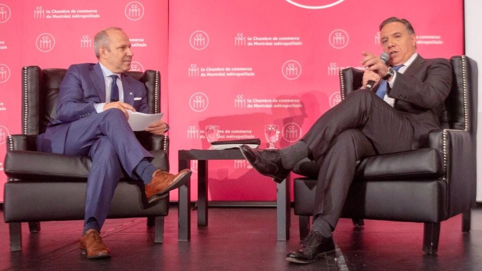 Coalition Avenir du Quebec leader Francois Legault, right, speaks to Chamber of Commerce President Michel Leblanc Friday, September 28, 2018 in Montreal. THE CANADIAN PRESS/Ryan Remiorz