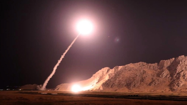 Iran's Revolutionary Guards fire missiles into Syria over deadly military parade attack