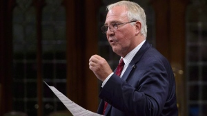 Bill Blair, Minister of Border Security and Organized Crime Reduction, stands during question period in the House of Commons on Parliament Hill in Ottawa on Monday, Sept. 17, 2018. Irregular border crossers being housed temporarily in hotels in Toronto will have their stays extended by four weeks while officials continue to search for a longer-term solution. (THE CANADIAN PRESS / Sean Kilpatrick)