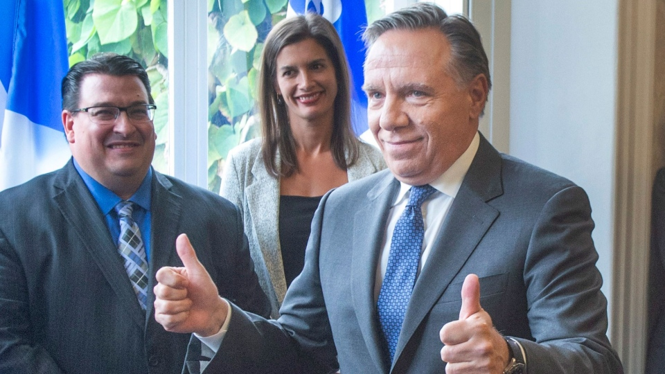 Quebec Premier-designate Francois Legault gives the thumbs up to some of his elected candidates after speaking to the media the day after after winning the provincial election Tuesday, October 2, 2018 in Quebec City.THE CANADIAN PRESS/Ryan Remiorz