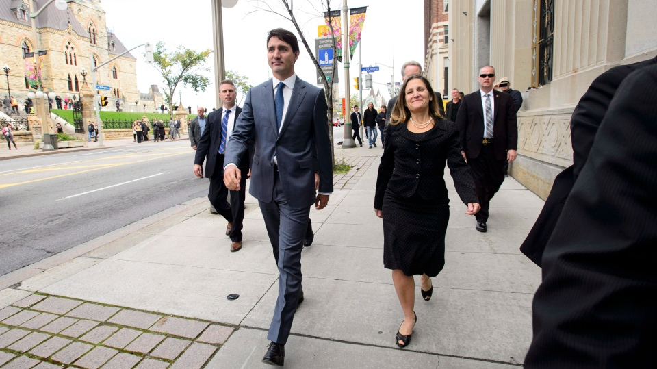 Prime Minister Justin Trudeau and Minister of Foreign Affairs Chrystia Freeland make their way to hold a press conference regarding the United States Mexico Canada Agreement (USMCA) at the National Press Theatre, in Ottawa on Monday, Oct. 1, 2018. THE CANADIAN PRESS/Sean Kilpatrick