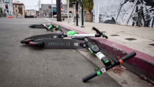 Four scooters lying curbside