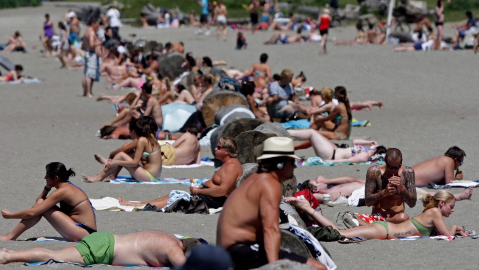 People pack English Bay Beach to sunbathe in Vancouver, B.C., on Wednesday June 3, 2009. Two British Columbia beaches have landed on a list of the world's top 50 beaches as ranked by the British newspaper The Guardian. THE CANADIAN PRESS/Darryl Dyck