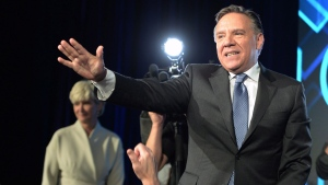 Coalition Avenir du Quebec leader and premier-elect Francois Legault arrives on stage to address supporters as he celebrates after winning the Quebec Provincial election in Quebec City on Monday, October 1, 2018. THE CANADIAN PRESS / Ryan Remiorz
