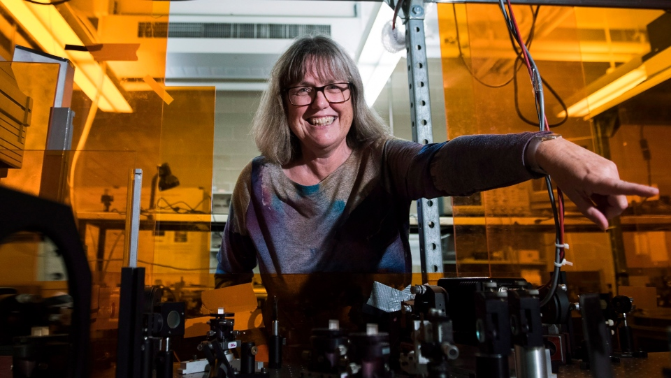Noble Prize winner Donna Strickland shows the media her lab after speaking about her prestigious award in Waterloo, Ont., on Tuesday, Oct. 2, 2018. THE CANADIAN PRESS/Nathan Denette