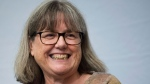 Noble Prize winner Donna Strickland smiles as she receives a standing ovation before speaking to the media during a press conference regarding her prestigious award in Waterloo, Ont., on Tuesday, Oct. 2, 2018. THE CANADIAN PRESS/Nathan Denette