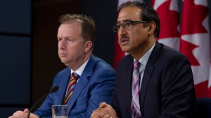 Parliamentary Secretary to the Minister of Natural Resources, Paul Lefebvre listens to Natural Resources Minister Amarjeet Sohi respond to a question about the government's plan for the Trans Mountain Expansion Project during a news conference in Ottawa, Wednesday October 3, 2018. THE CANADIAN PRESS/Adrian Wyld