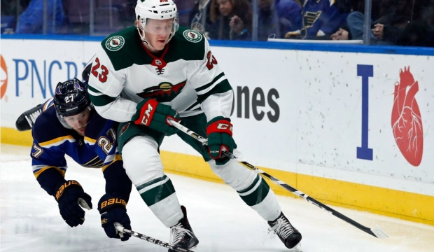 FILE - In this Feb. 6, 2018, file photo, Minnesota Wild's Gustav Olofsson, right, of Sweden, and St. Louis Blues' Alex Pietrangelo (27) chase after a loose puck along the boards during the third period of an NHL hockey game in St. Louis. The Wild have traded Olofsson on Wednesday, Oct. 3, 2018, to the Montreal Canadiens for minor league forward Will Bitten. (AP Photo/Jeff Roberson, File)