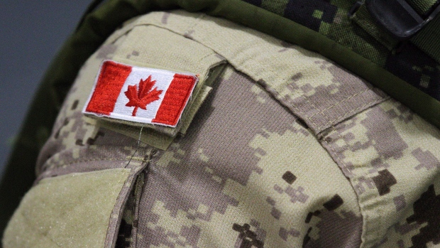 A Canadian flag on the shoulder of a military member is shown in this file image.