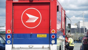 Canada Post says its operations are back to normal across the country, less than four weeks after its striking employees were forced back to work by federal legislation. (Darren Calabrese/ The Canadian Press)