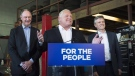 Premier Doug Ford, centre, speaks to the media with Rod Phillips, right, Minister of the Environment, Conservation and Parks, and John Yakabuski, Minister of Transportation regarding the decision to cancel the Ontario Drive Clean program in Toronto, on Friday, September 28, 2018. (THE CANADIAN PRESS/Nathan Denette)