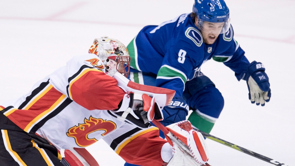 Vancouver Canucks left wing Brendan Leipsic (9) fights for control of the puck with Calgary Flames goaltender Mike Smith (41) during third period NHL action at Rogers Arena in Vancouver, Wednesday, Oct, 3, 2018. (THE CANADIAN PRESS / Jonathan Hayward)