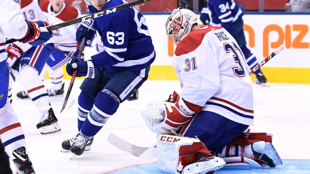 Montreal Canadiens goaltender Carey Price (31) makes a save as Toronto Maple Leafs centre Tyler Ennis (63) looks for the rebound during second period NHL hockey action in Toronto on Wednesday, October 3, 2018. THE CANADIAN PRESS/Nathan Denette