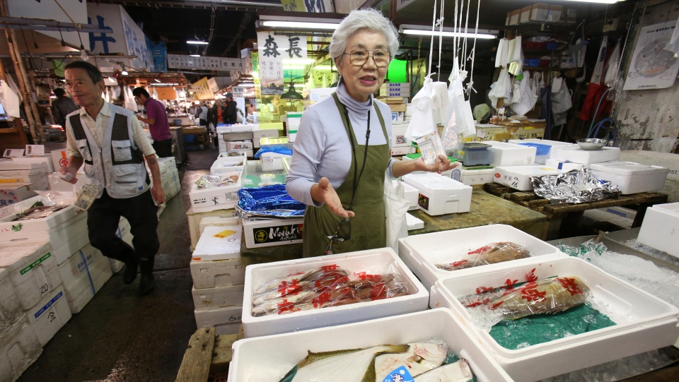 In this Sept. 26, 2018, photo, Tai Yamaguchi of fish wholesaler Hitoku Shoten, speaks during an interview with the Associated Press at Tsukiji fish market in Tokyo. (AP Photo/Koji Sasahara)