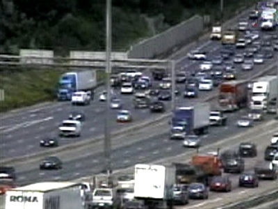 The allegedly hijacked truck is seen on the far side of Highway 401 near Leslie St. on Thursday, July 2, 2009.