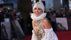 Actor and singer Lady Gaga poses for photographers upon arrival at the premiere of the film 'A Star Is Born' in London, Sept. 27, 2018. (Vianney Le Caer/Invision/AP)