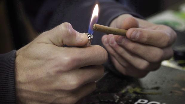 A man lights a marijuana joint in Denver on Tuesday, April 25, 2017. THE CANADIAN PRESS/Joe Mahoney