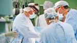 A team of doctors perform surgery. (Dmitry Kalinovsky / Shutterstock)