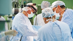 A team of doctors perform surgery. (Dmitry Kalinovsky / Shutterstock)