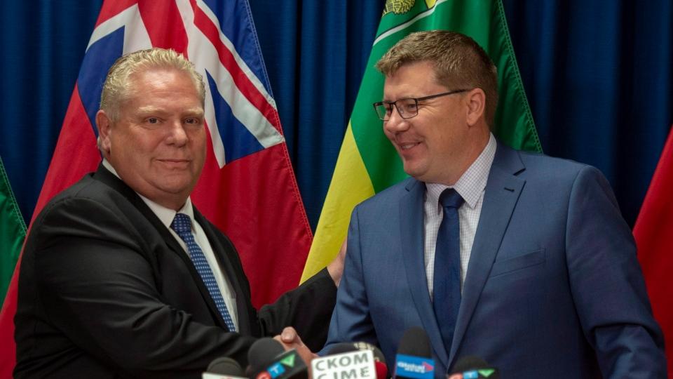 Premier of Ontario Doug Ford, left, and Premier of Saskatchewan Scott Moe during a media event in Saskatoon, Thursday, October 4, 2018. THE CANADIAN PRESS/Liam Richards