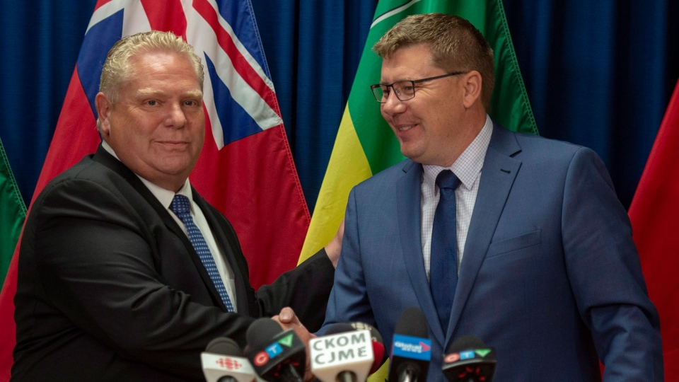 Premier of Ontario Doug Ford, left, and Premier of Saskatchewan Scott Moe during a media event in Saskatoon, Thursday, October 4, 2018. THE CANADIAN PRESS/Liam Richards