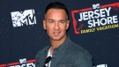 """In this March 29, 2018 file photo, Mike """"The Situation"""" Sorrentino arrives at the """"Jersey Shore Family Vacation"""" premiere in Los Angeles. (Willy Sanjuan/Invision/AP, File)"""