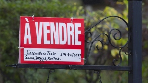 A home for sale sign is shown on the west island of Montreal, Saturday, November 4, 2017. (THE CANADIAN PRESS/Graham Hughes)