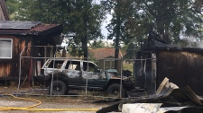 A vehicle and garage destroyed by fire