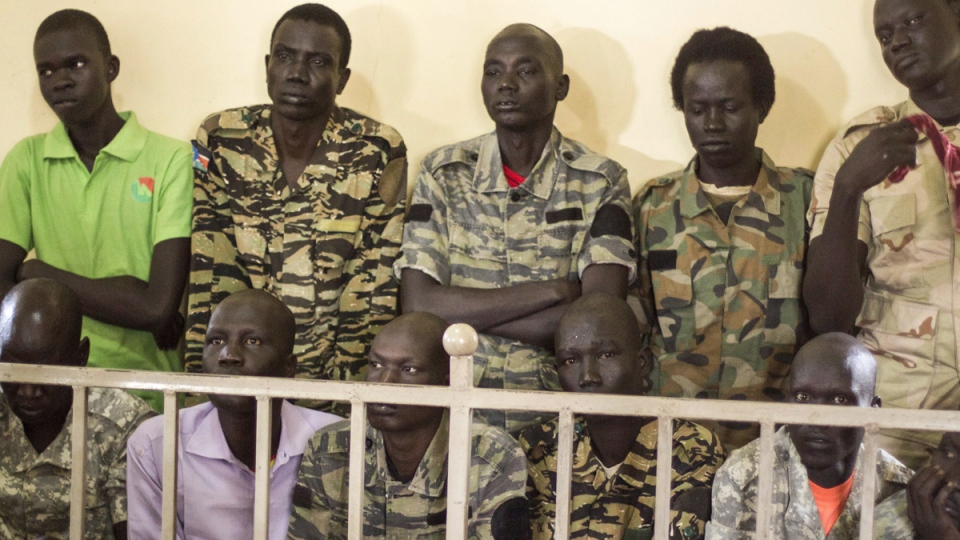 South Sudanese soldiers listen to the verdict being delivered at their trial in a military courtroom in Juba, South Sudan, on Sept. 6, 2018. (AP)